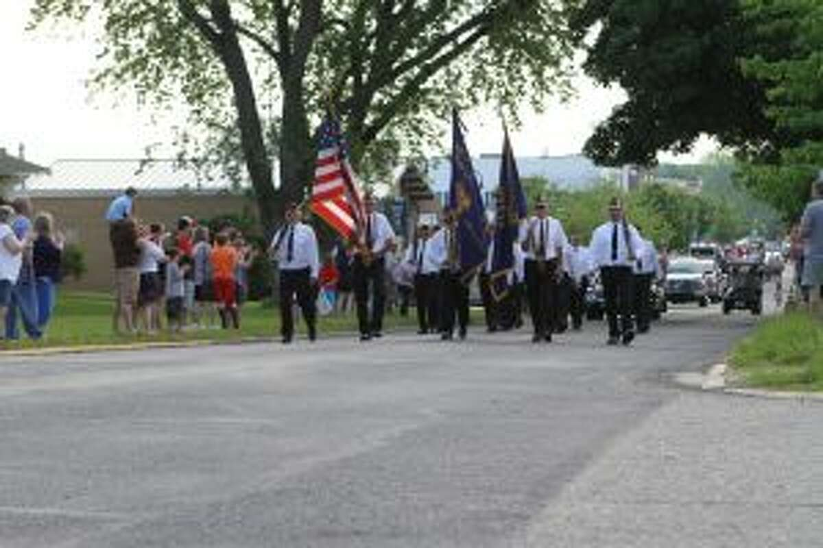 The parade route led participants from the Reed City Depot, down Upton Avenue and paused in front of the courthouse before continuing on to Woodland Cemetery.