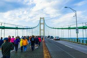 Walkers cross the Mackinac Bridge during the 2014 Bridge Walk. For the 2018 event, the Mackinac Bridge Authority (MBA) voted to have walkers begin at each end of the bridge, then turn around at the midpoint to return to the side where they began. (Pioneer file photo)