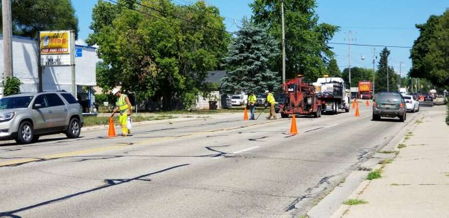 During last year's construction season, portions of South Third Avenue were closed for road work. This summer, several road work projects are scheduled throughout the city, including paving and water main replacements. (Pioneer file photo)