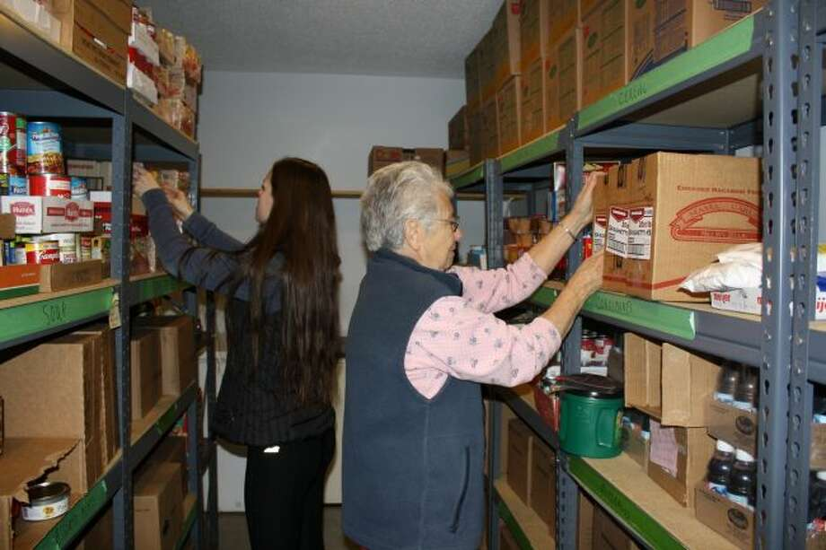 Workers at Manna Pantry collect and organize food for hungry people in Mecosta and Osceola Counties. Their third annual Share the Harvest event will help the organization raise money to continue supporting those in need. (Pioneer file photo)