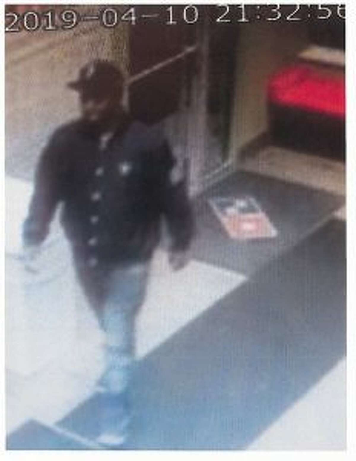 One of the suspect's who allegedly passed counterfeit $100 bills at area businesses on Wednesday night is seen in video footage, provided by the Big Rapids Department of Public Safety. (Courtesy photo)
