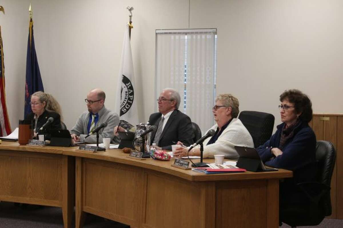 Members of the Big Rapids City Commission listen to a presentation during Monday's meeting. Officials approved providing $10,000 to an effort to renovate the entrance building at Highland View Cemetery. (Pioneer photo/Brandon Fountain)