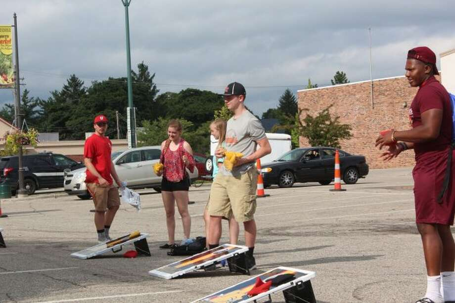 Students play games in the City Hall parking lot during the Big Rapids Beginnings event in 2016. (Pioneer file photo)