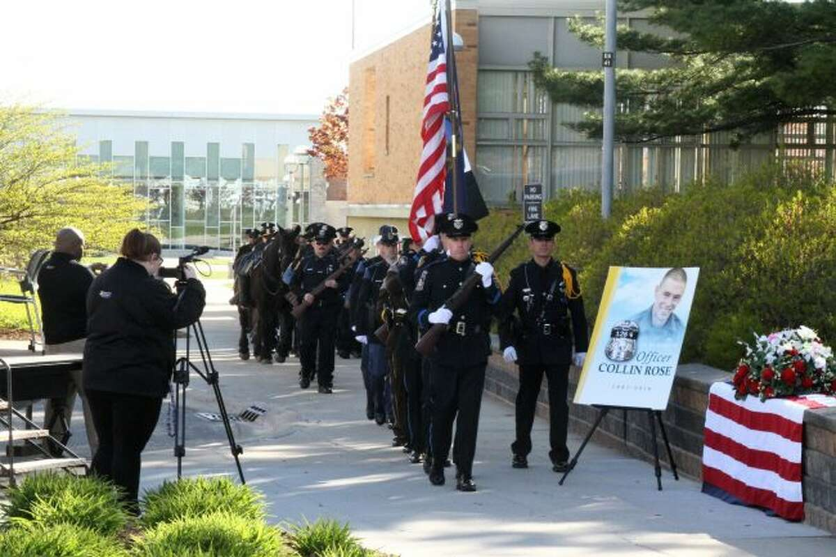 OFFICERS UNITED: Police officers from various local departments march together during the Police Memorial Ceremony to begin the service.