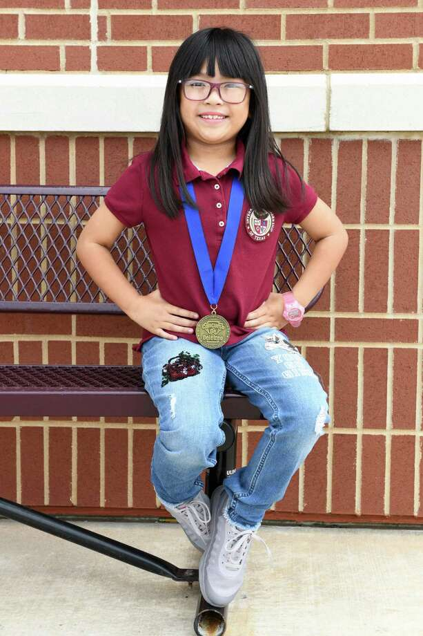 Kirsten Santos wears her Championship Medal at the International Leadership of Texas Katy K-8 Charter School in Katy, TX on Tuesday, July 23, 2019. Kirsten was co-champion of the 2018 National Spanish Spelling Bee competition held in Denver, CO. Photo: Craig Moseley, Houston Chronicle / Staff Photographer / ©2019 Houston Chronicle