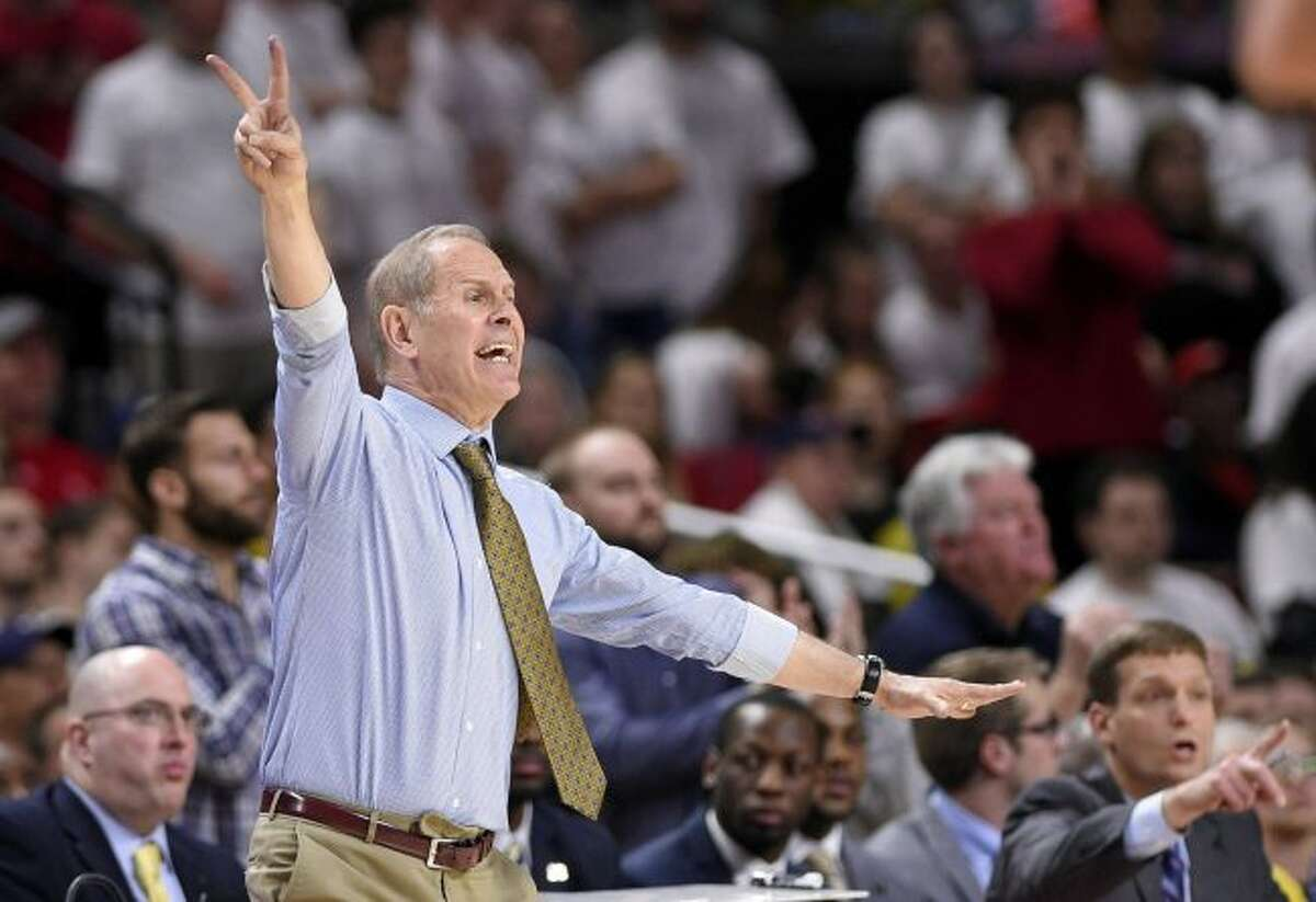In this Feb. 24, 2018, file photo, Michigan head coach John Beilein gestures during the second half of an NCAA college basketball game against Maryland in College Park, Md. Beilein has stood the test of time in basketball, coaching since the mid-1970s and earning one of the best reputations in the game as a teacher and a man of integrity. (AP Photo/Nick Wass, File)
