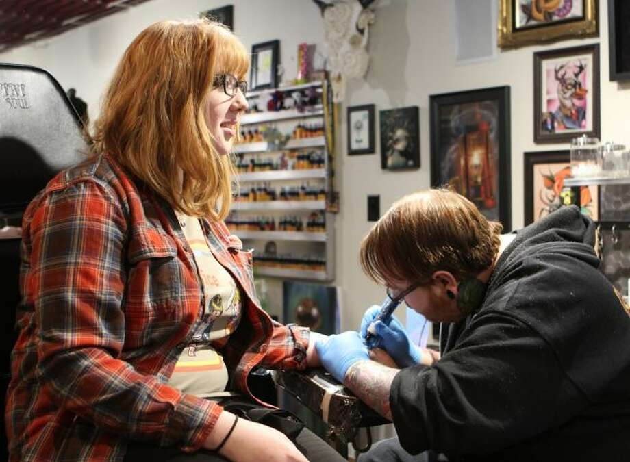 Ferris State University student Annabelle Kinna, of Jackson, has a semicolon tattooed on her wrist Thursday during a special promotion by Lighttouch Tattoo to recognize Suicide Awareness Day. Proceeds and tips from the day were donated by Lighttouch Tattoo to West Michigan Survivors of Suicide. (Pioneer photo/Brandon Fountain)