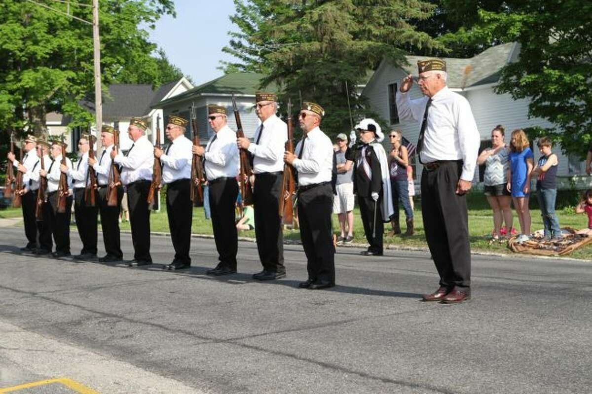 The rifle squad prepares to salute their fallen comrades during a short ceremony at the courthouse on Monday as part of the annual Memorial Day celebration in Reed City. (Pioneer photos/Meghan Gunther-Haas)