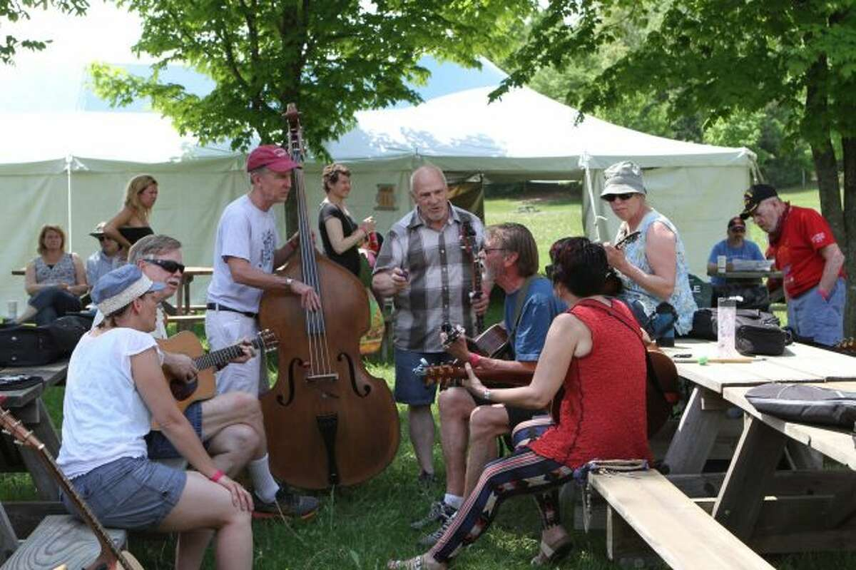 Wheatland Traditional Arts Weekends attendees participate in a jam session between classes on Saturday. Lessons focusing on all different kinds of art took place from Friday afternoon to Sunday evening at the festival grounds near Remus. (Pioneer photos/Meghan Gunther-Haas)