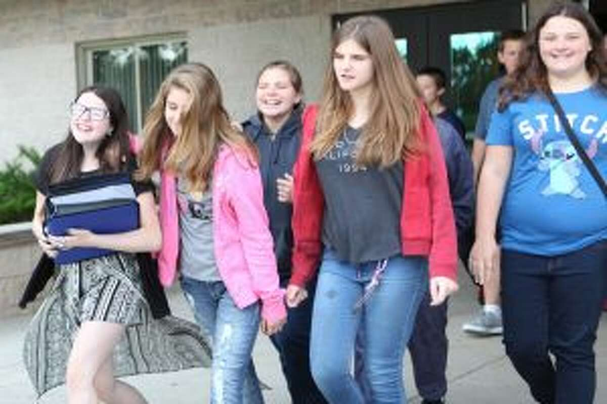 After starting the school day, Evart middle-schoolers leave the high school building, where they were dropped off, and board buses headed to SpringHill Camps. Middle school students will spend today, Friday, Aug. 25, and Monday, Aug. 28, at the camp while work is completed at their building.