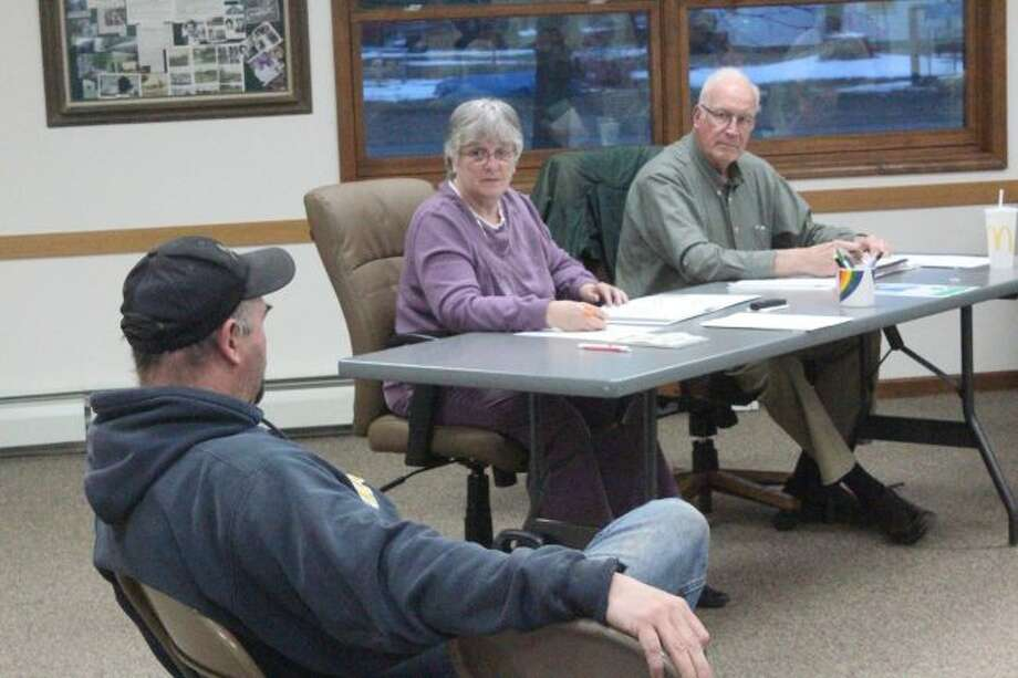 Green Township Trustees Nancy Stephan (middle) and Jim Peek (right) listen to Troy McDonald, sewer system supervisor, deliver his monthly report during Tuesday's monthly meeting. Officials are trying to find out why there has been such a large increase in flow through the township's sewer system. (Pioneer photo/Brandon Fountain)