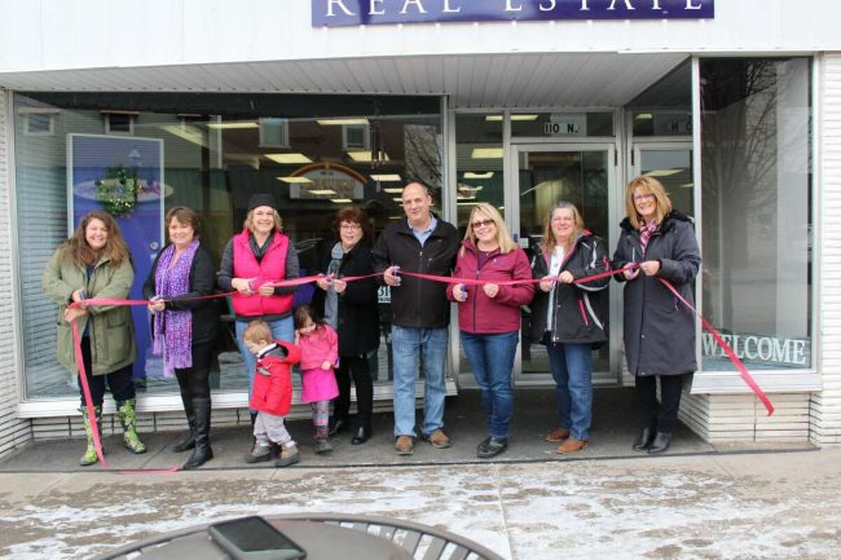 Rockgate Real Estate owner Jackie Bissonette and the agents employed by the company had a ceremonial ribbon-cutting at each location recently. All three locations will have an open house from 11 a.m. to 3 p.m. on Saturday, March 24. (Courtesy photo)