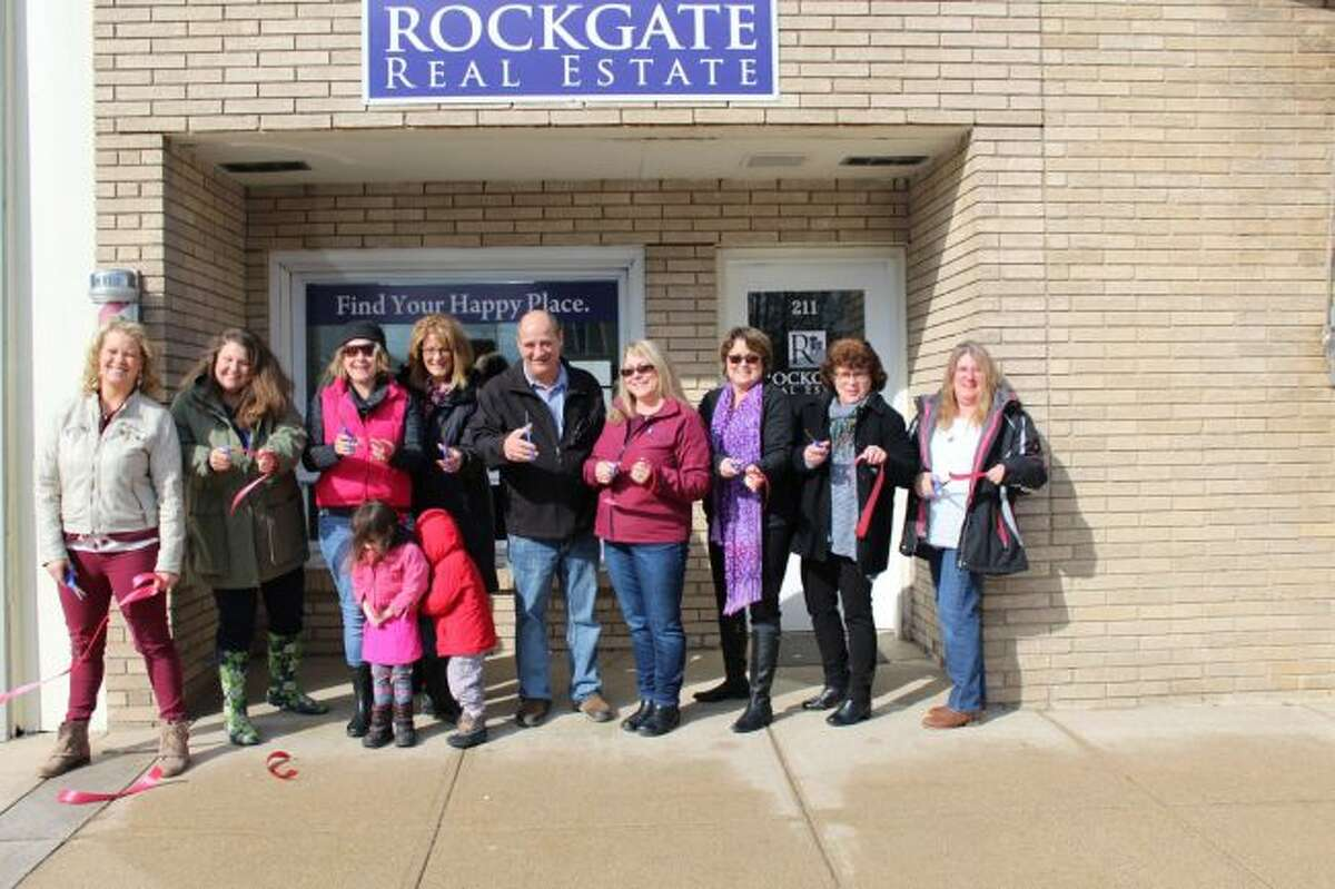 Rockgate Real Estate owner Jackie Bissonette and the agents employed by the company had a ceremonial ribbon-cutting at each location recently. All three locations will have an open house from 11 a.m. to 3 p.m. on Saturday, March 24. (Courtesy photos)