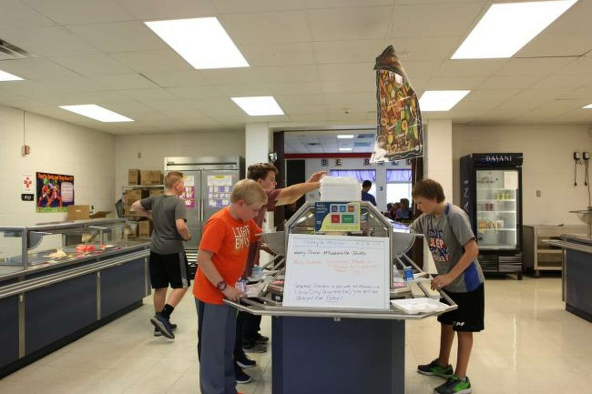 Students file past the salad bar at Big Rapids Middle School. Approximately 50 percent of students in the district receive free or reduced lunches. The free and reduced lunch participation rate drops off after elementary school. (Pioneer photos/Meghan Haas)