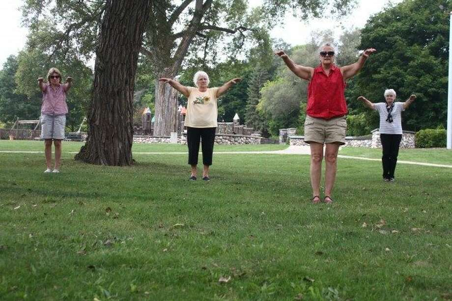 In this file photo, instructor Mary Loesch leads her Tai Chi class in exercises at Hemlock Park. There are several programs being offered this spring by the Big Rapids Parks and Recreation Department. (Pioneer file photo)