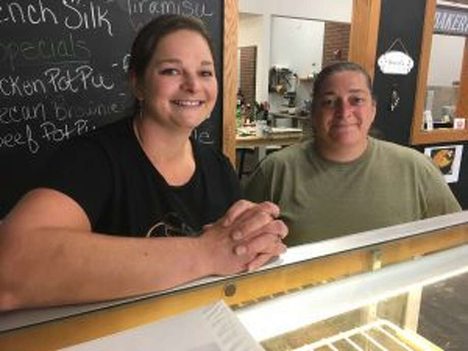Niki Stricker, left, who owns The Pie Hole bakery in downtown Big Rapids, poses Thursday with her sister, Elizabeth Ottobre, who frequently assists in the kitchen. The Pie Hole recently moved to a new location. (Pioneer photo/Tim Rath)