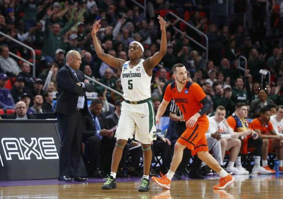 Michigan State guard Cassius Winston (5) reacts to hitting a basket against Bucknell during the first half of an NCAA men's college basketball tournament first-round game in Detroit, Friday, March 16, 2018. (AP Photo/Paul Sancya)