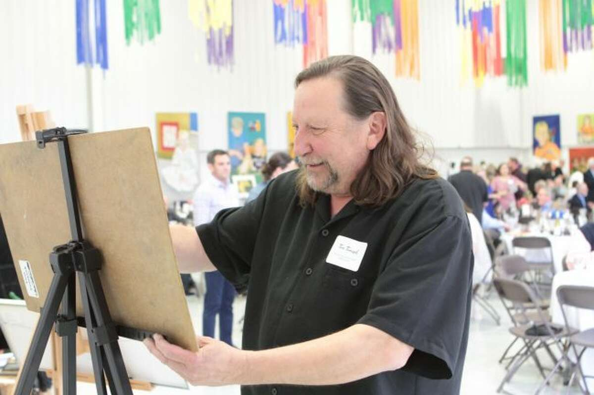 Artist Tom Tomasek works on a dry pastel drawing of a landscape during the 2019 Artworks Gala. His work was auctioned off during the event to one lucky guest.
