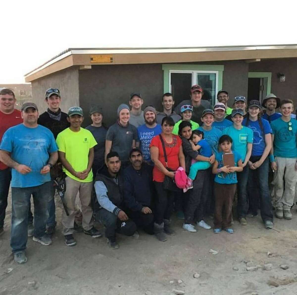 DEDICATION: A group of students stand with the family they built a house for in Juarez, Mexico. (Submitted photos)