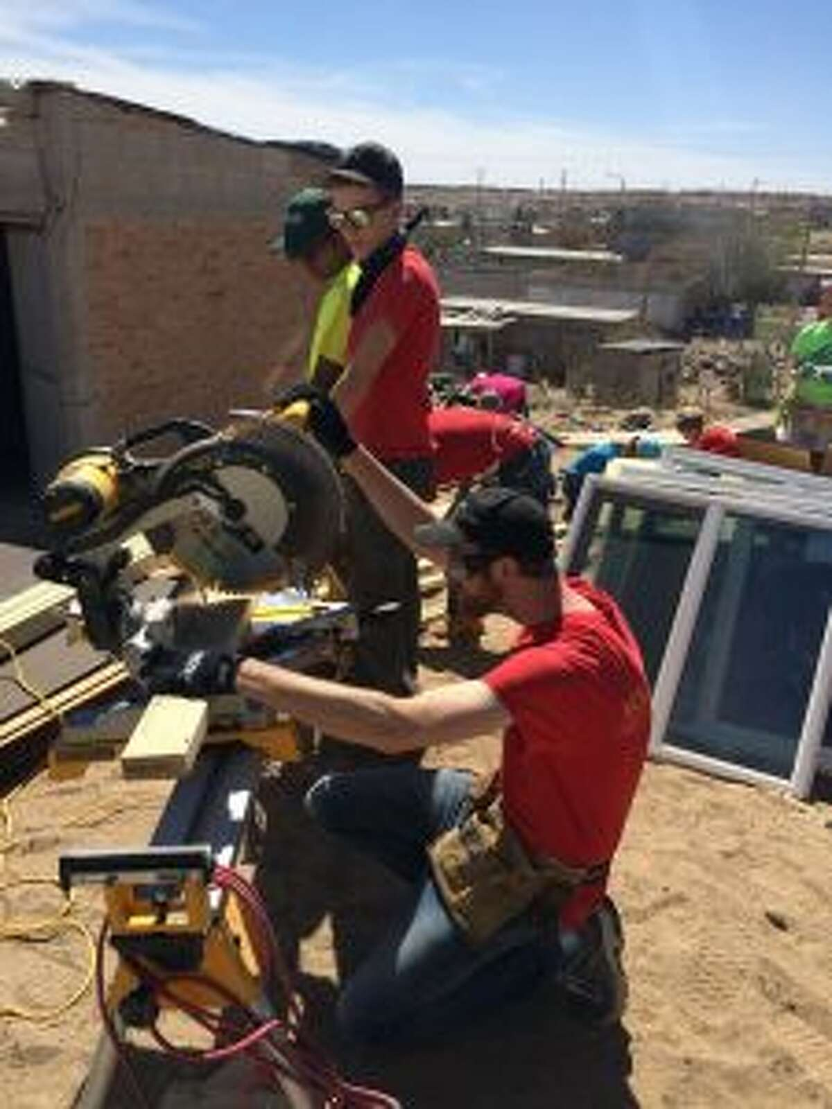 HOME BUILDING: Students from Ferris State University work during their spring break to build a house for a family in need.