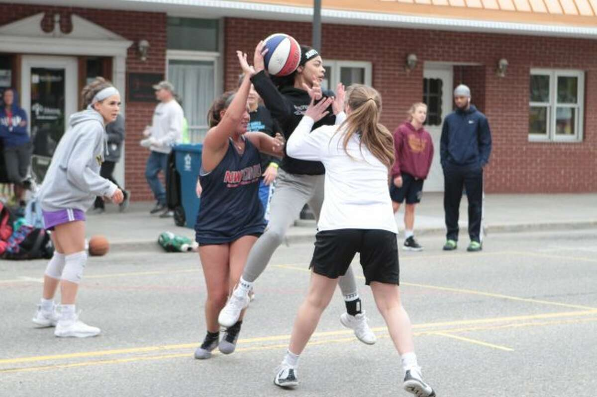 Hundreds of people participated in the Gus Macker tournament in downtown Big Rapids this weekend. The nationwide event brings together players of all ages to compete in numerous rounds of 3 on 3 basketball games, all in an effort to support a local cause. (Pioneer photos/Taylor Fussman)