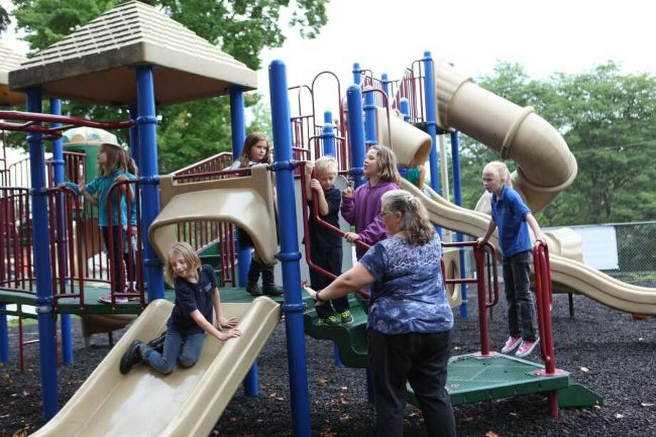 After a morning full of learning about their teachers and classes, Crossroads Charter Academy second- and third-grade students spend some time on the playground for recess before heading back inside to finish their firs day back to school. (Pioneer photos/Meghan Haas)