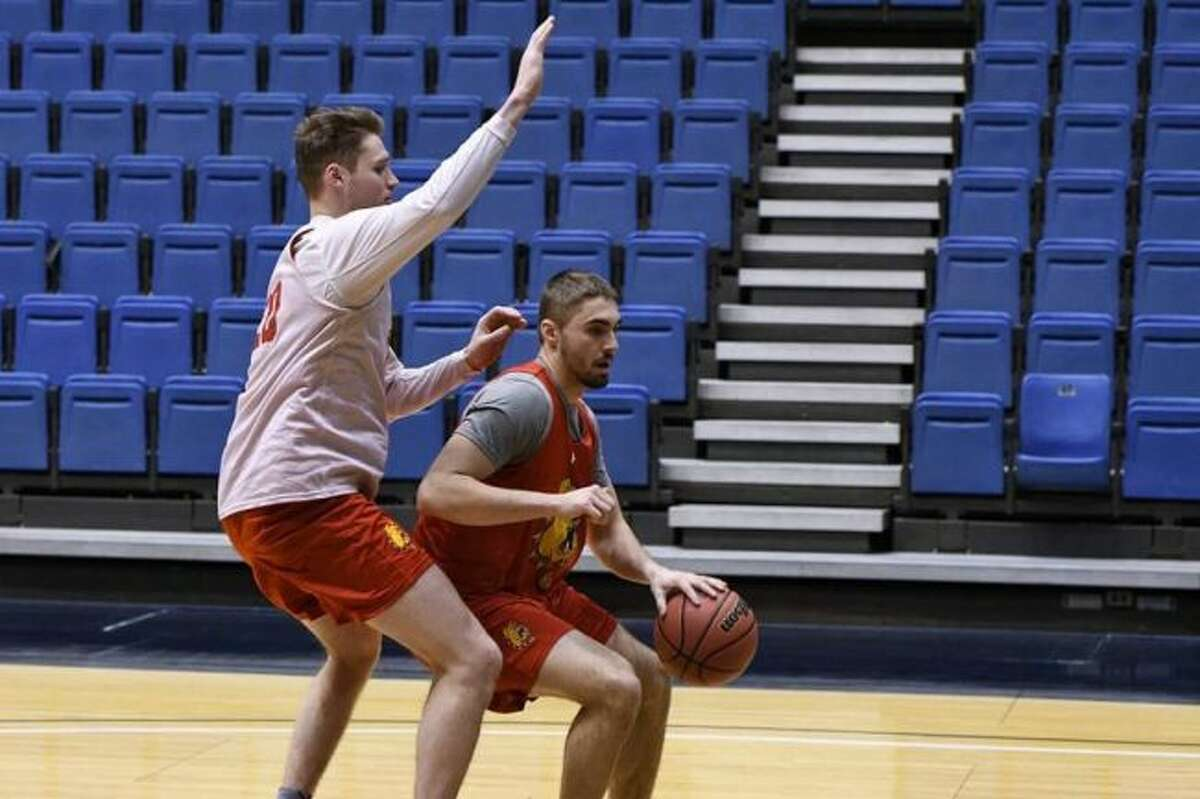 Ferris State's Peter Firlik (right) attempts to get by Peyton Staples (left) during a practice Monday in Sioux Falls, SD. (Photo courtesy of Kevin T. McDermott/Ferris State Athletics)