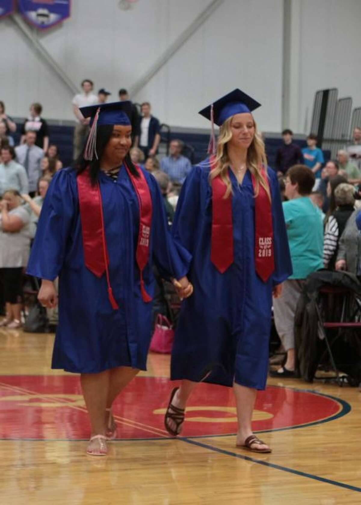 Students of Crossroads Charter Academy make their way into the high school gym to partake in the graduation ceremonies.
