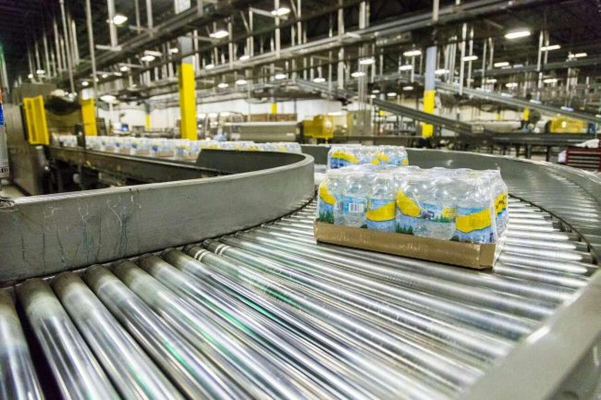 In this November 2016 photo, Ice Mountain Spring Water moves down the production line at Nestlé Waters North America's Ice Mountain bottling facility in Stanwood. In a hearing scheduled for Nov. 15, NWNA will ask a visiting judge to overturn a Osceola Township zoning permit denial. (Pioneer file photo)