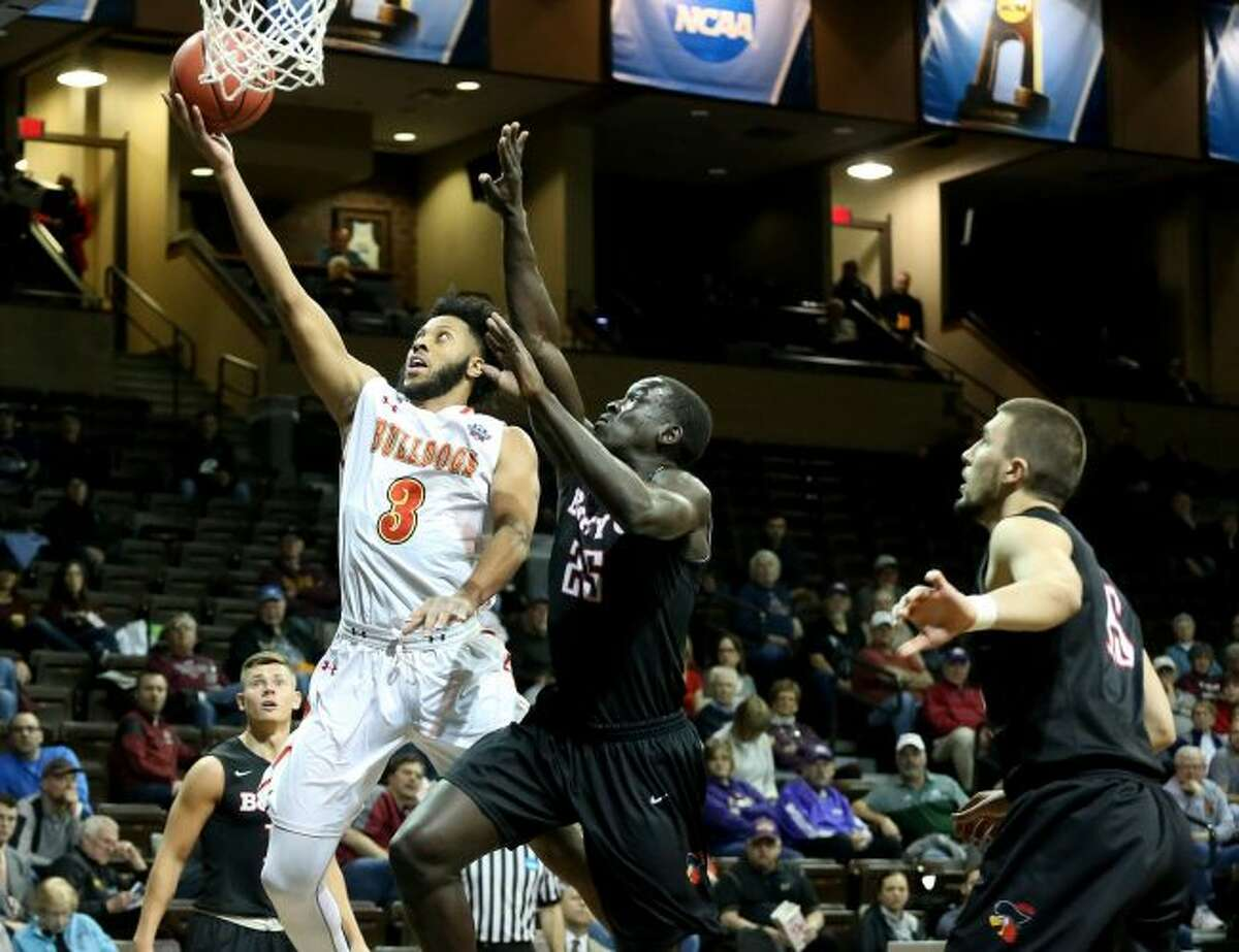 Ferris State's Markese Mayfield (3) skies for a lay-up while defended by Barry's Sunday Dech during Tuesday's NCAA Division II Elite Eight game in Sioux Falls, SD. (Photo courtesy of Dave Eggen)