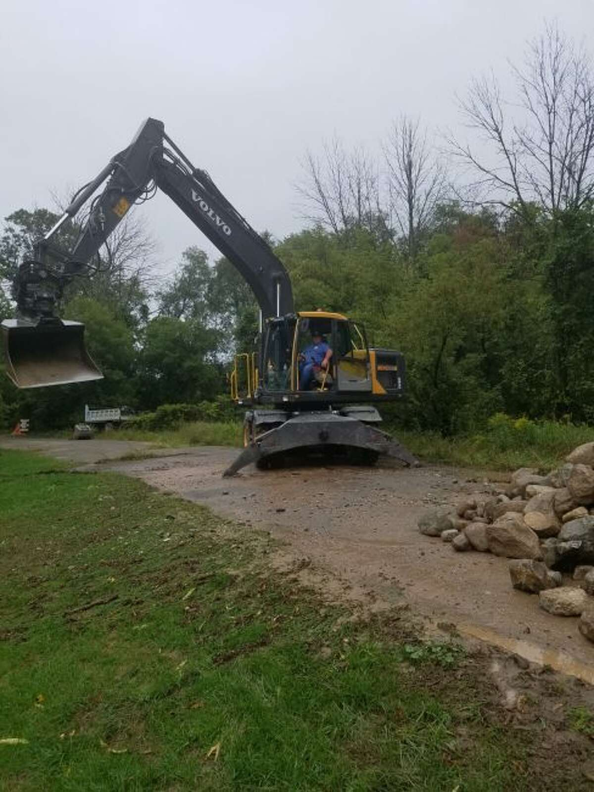 Scott Morningstar, with Morningstar Excavating, began work on the construction of a culvert at Spruce Road in Green Township on Tuesday. (Courtesy photo)