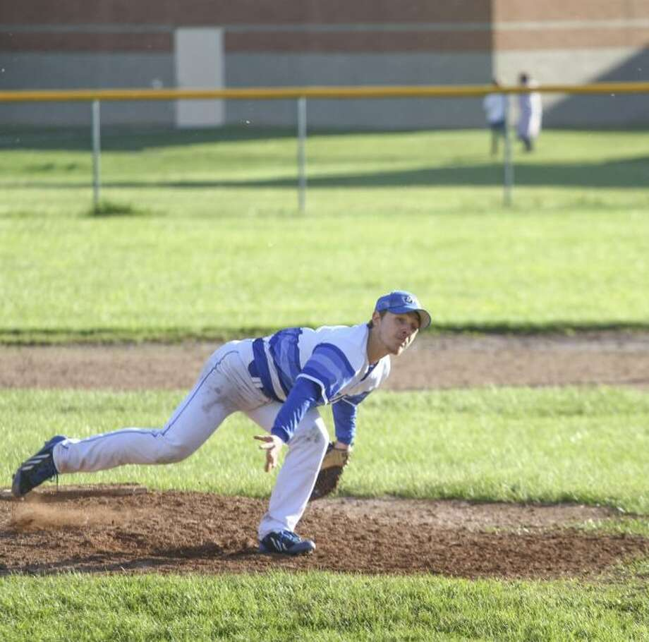 Morley Stanwood pitcher James Dodge (12) fires off a pitch during game two of Morley Stanwood's doubleheader against Kent City on Monday. (Pioneer photo/Maxwell Harden)