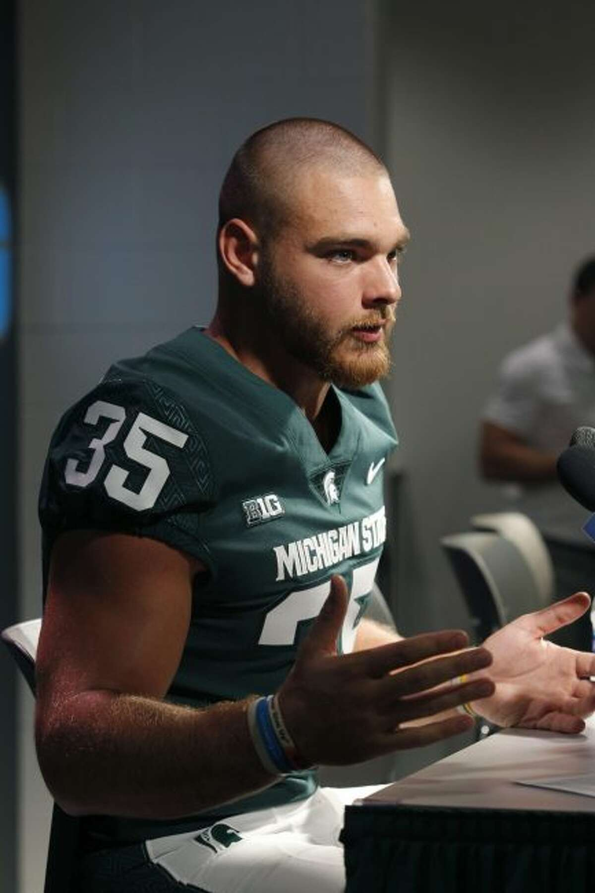 Michigan State linebacker Joe Bachie talks with reporters during the team's NCAA college football media day, Monday, Aug. 6, 2018, in East Lansing, Mich. (AP Photo/Al Goldis)