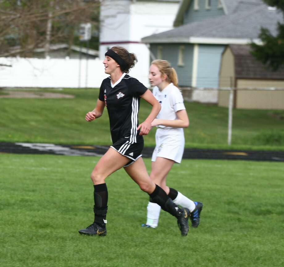 Taylor Harrison (2) smiles after scoring a goal in the second half of Tuesday's game. (Pioneer photo/Maxwell Harden)