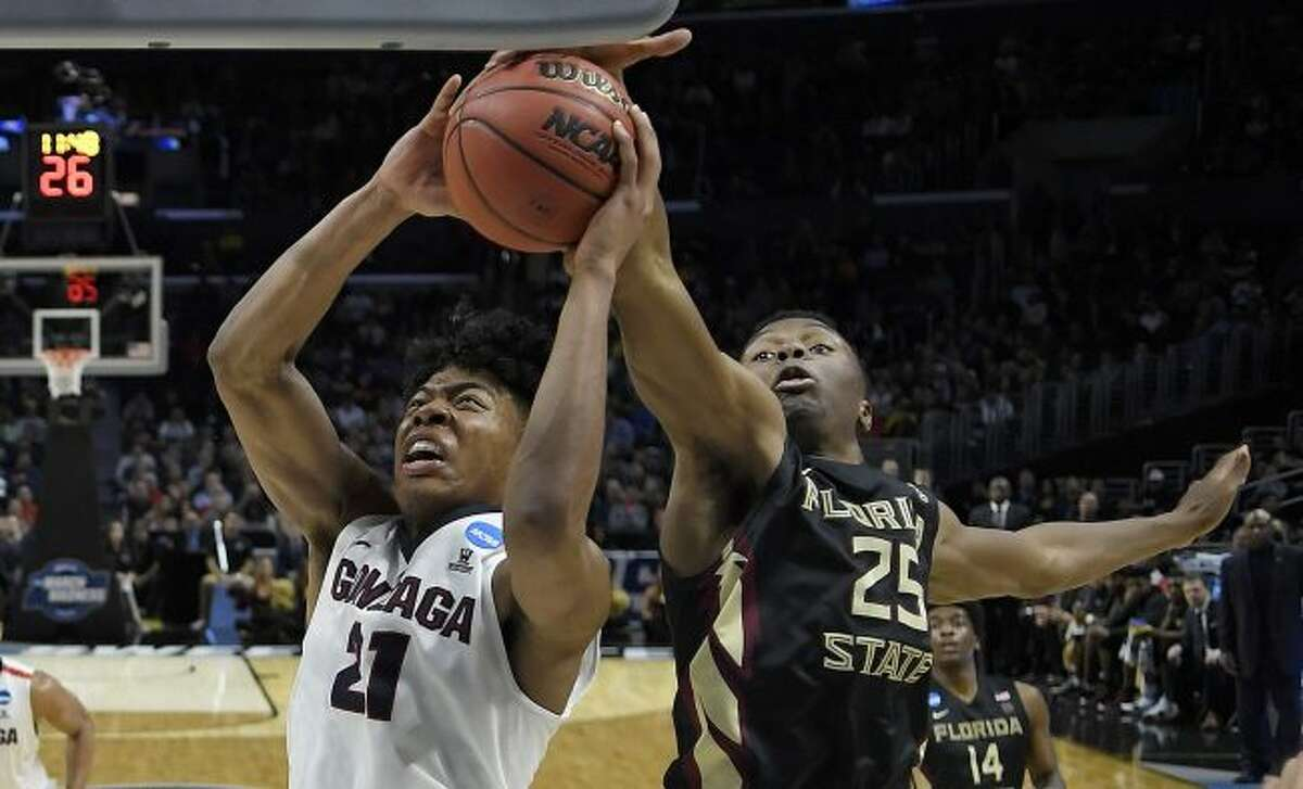 Florida State forward Mfiondu Kabengele (25) defends on a shot by Gonzaga forward Rui Hachimura (21) on Thursday, March 22, 2018, in Los Angeles. (AP Photo/Jae Hong)