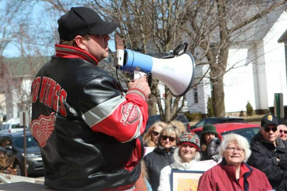 Christopher Gillespie speaks during the March for Our Lives on Saturday afternoon. Gillespie organized the local event that mirrored the national movement to end gun violence. About three dozen area residents participated in the march. (Pioneer photo/Brandon Fountain)