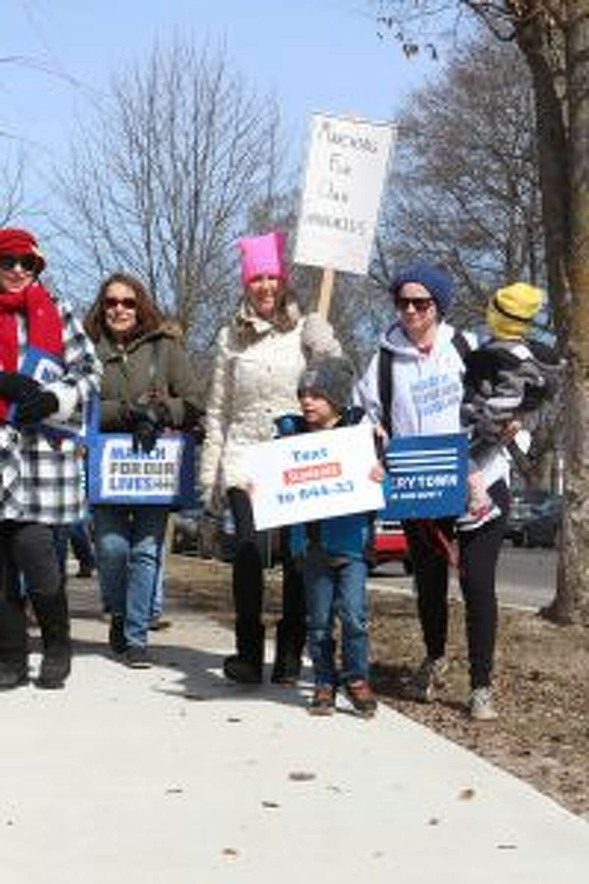 Residents of all ages walk with signs during Saturday's March for Our Lives event. (Pioneer photo/Brandon Fountain)