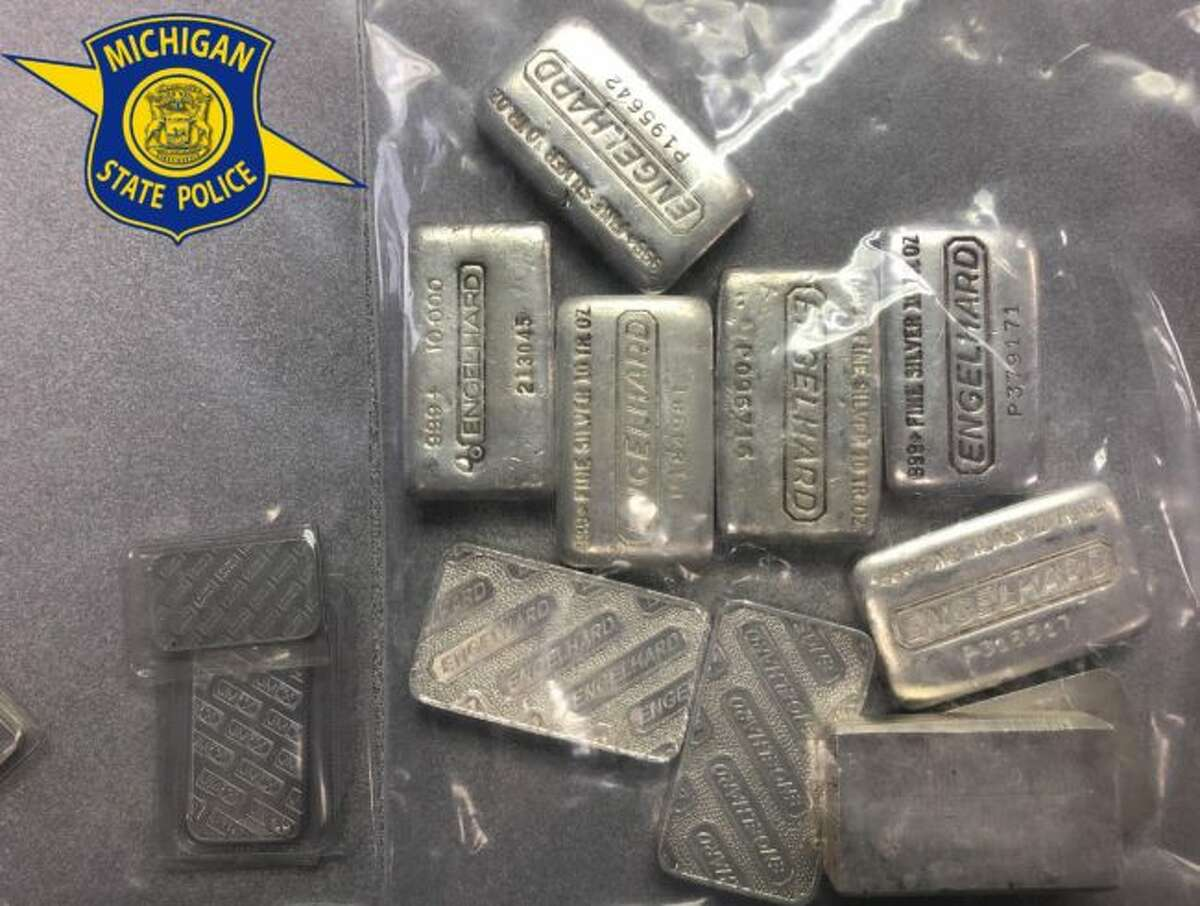 Silver and platinum bars were found in the backyard of a LeRoy home, following a tip to Michigan State Police troopers about the alleged activity of Scott McDaniel. McDaniel faces a slew of charges in Wexford County. (Courtesy photo)
