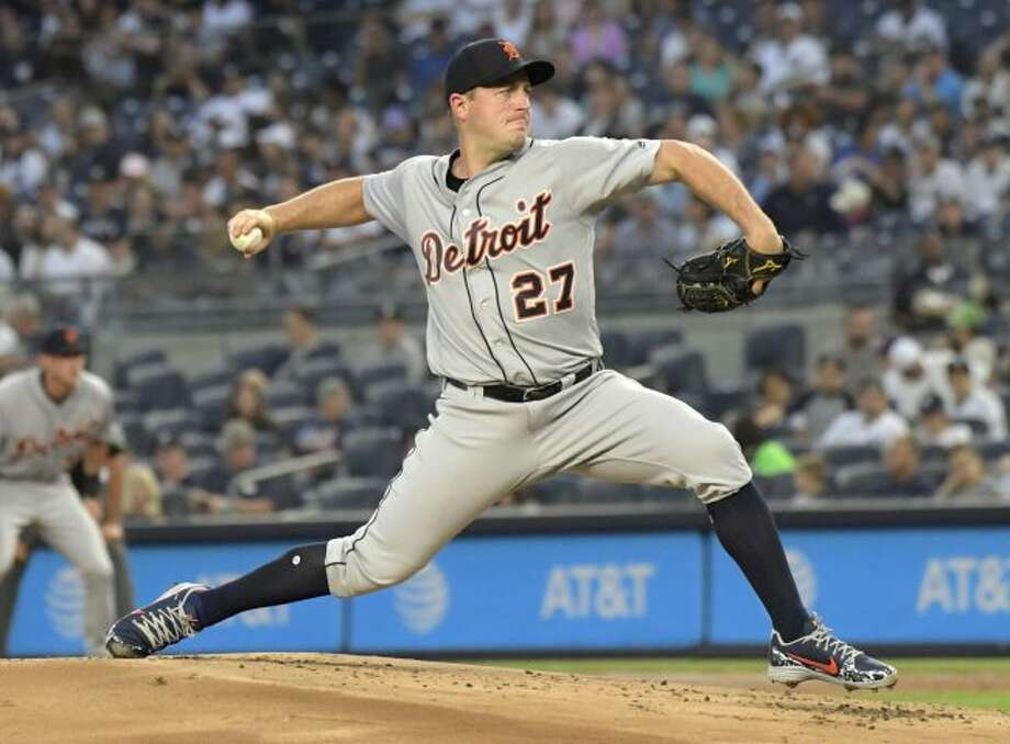 Detroit Tigers starting pitcher Jordan Zimmermann delivers the ball to the New York Yankees during the first inning of a baseball game Friday, Aug. 31, 2018, at Yankee Stadium in New York. (AP Photo/Bill Kostroun)