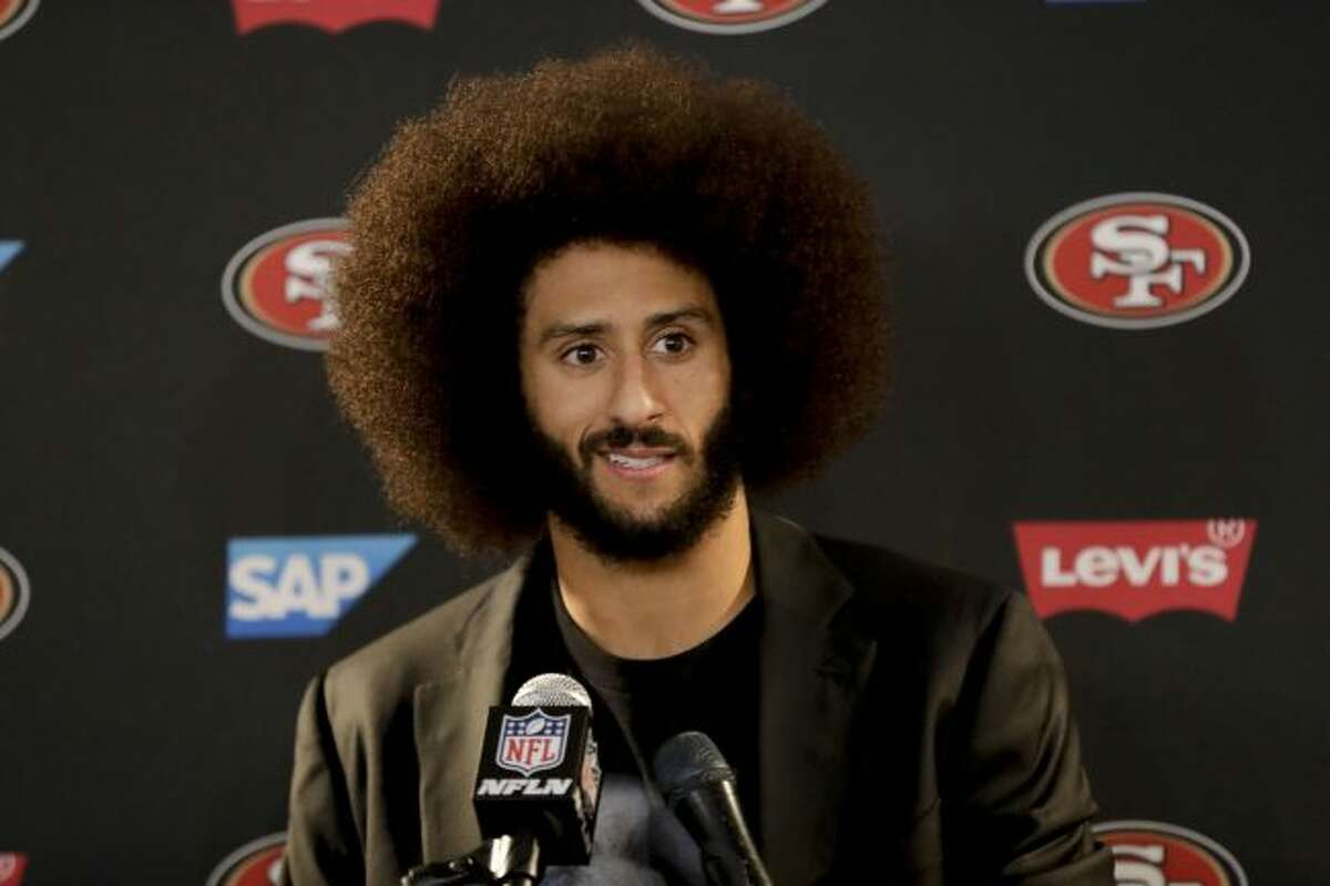 In this Dec. 24, 2016, file photo San Francisco 49ers quarterback Colin Kaepernick talks during a news conference after an NFL football game against the Los Angeles Rams. The free agent quarterback was named GQ magazine's