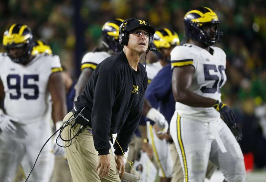 Michigan head coach Jim Harbaugh watches a replay in the first half of an NCAA football game against Notre Dame in South Bend, Ind., Saturday, Sept. 1, 2018. (AP Photo/Paul Sancya)