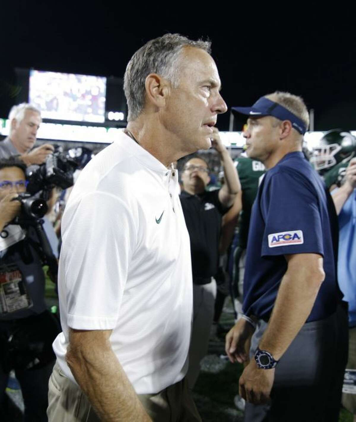 Michigan State coach Mark Dantonio reacts following a win over Utah State in an NCAA college football game, Friday, Aug. 31, 2018, in East Lansing, Mich. (AP Photo/Al Goldis)