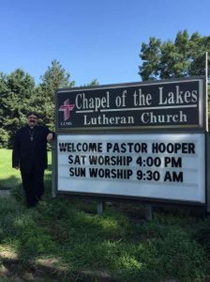 The Rev. Will Hooper, who recently took over as pastor of Chapel of the Lakes Lutheran Church, poses near the church marquee in this undated photo. (Courtesy photo)