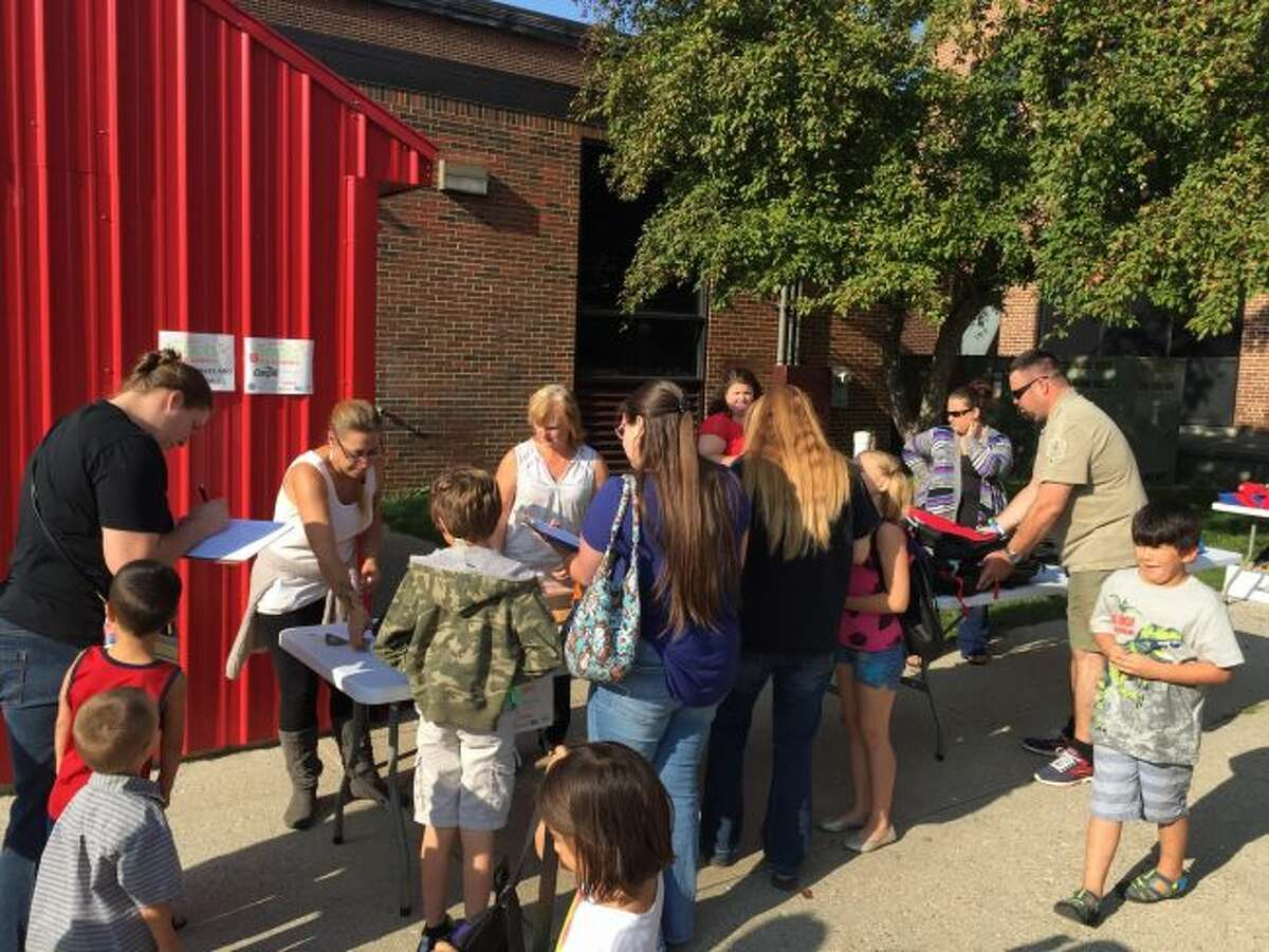 Families gather to sign up for their new backpacks and school supplies at the Crossroads Charter Academy Elementary back-to-school night. (Courtesy photo)