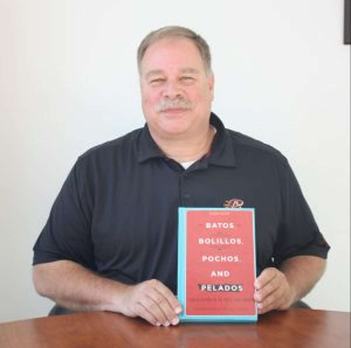 Michael Pisani poses for a photo with the extensively revised and updated