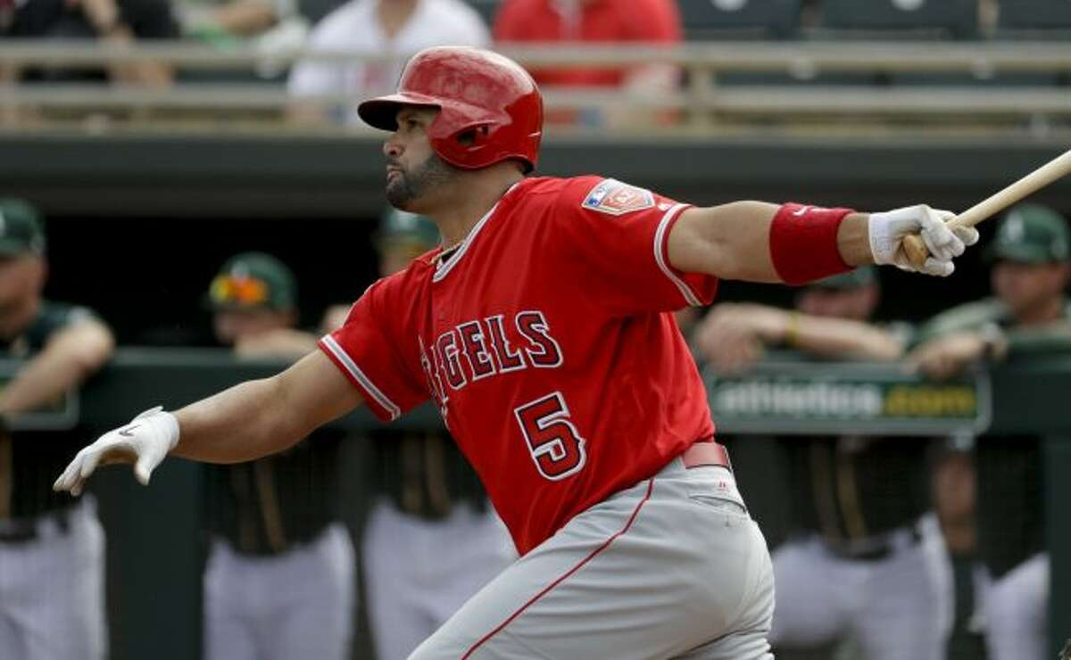 In this Thursday, March 8, 2018, file photo, Los Angeles Angels' Albert Pujols watches his RBI-single against the Oakland Athletics during the first inning of a spring baseball game in Mesa, Ariz. With Pujols only 32 hits away from 3,000 in his career, this likely will be the fourth straight season a player joins the prestigious club. (AP Photo/Chris Carlson, File)