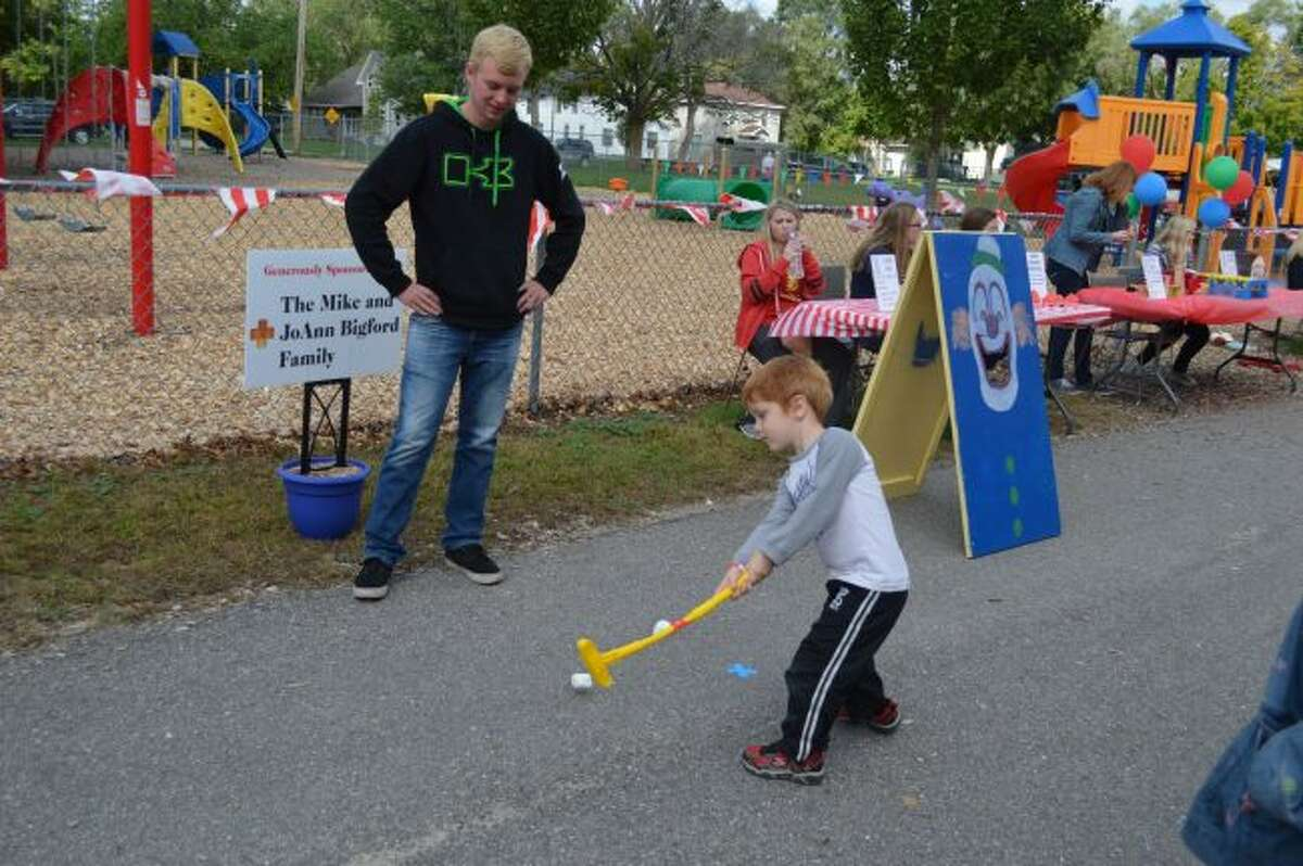 A child swings his putter while participating in the 2015 Fun Fest marshmallow golf game. This year, the event will take place from 10:30 a.m until 3 p.m. on Sunday, Sept. 10, at the St. Mary Parish Center. (Pioneer file photos)