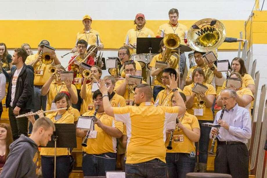 Ferris president David Eisler (lower right) plays the clarinet as a member of the Bulldog prep band during the season. (Courtesy photo)