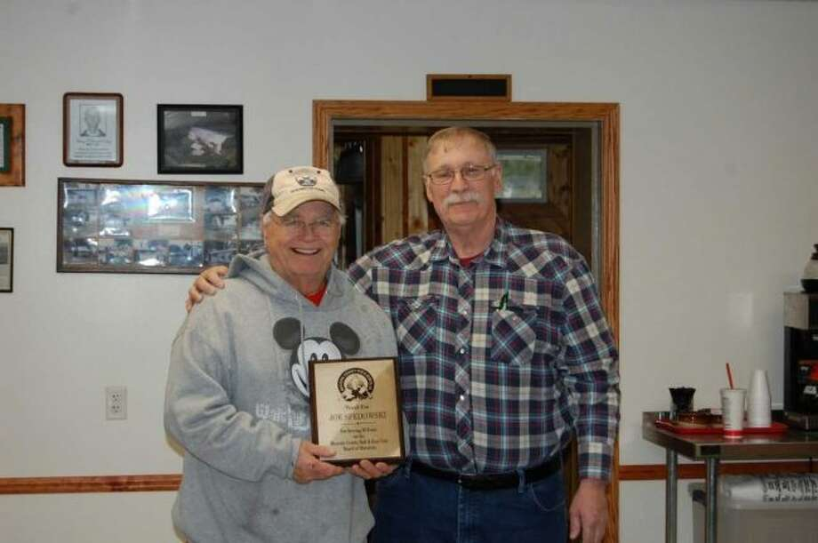 Mecosta County Rod and Gun Club President Randy Rice (right) presented Joe Spedowski with a plaque for his 50 years of service with the club during the May board of directors meeting. (Courtesy photo)