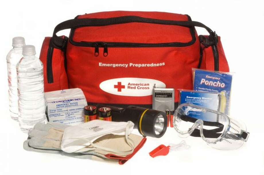 """A Red Cross """"ready to go"""" preparedness kit showing the bag and its contents. (Photo courtesy FEMA.gov)"""